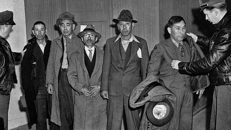 Japanese Americans arrested in LA, likely bound for internment in camps, sometime in 1942.