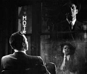 Marlowe first meets Malloy as a ghostly reflection in his grimy office window.