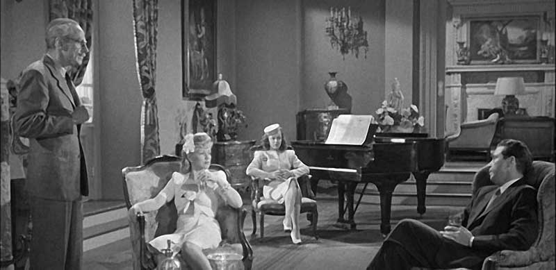 Miles Mander as Leuwen Grayle, Claire Trevor as Helen Grayle, Anne Shirley as Ann Grayle, and Dick Powell as Philip Marlowe.