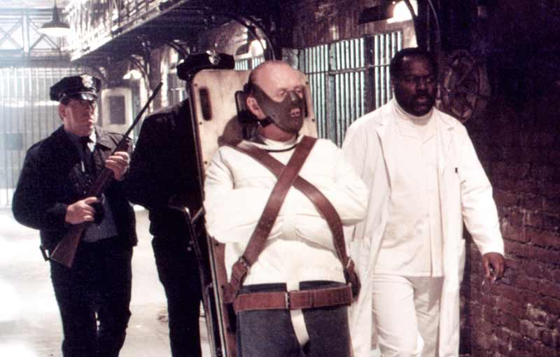 A man so dangerous he needs to be trussed to a trolley.  Seen here with nurse Barney (Frankie Faison), who plays a much more significant rôle in the novel.