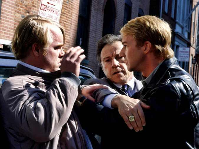 Philip Seymour Hoffman as Freddy Lounds, Harvey Keitel as Jack Crawford, and Edward Norton as Will Graham.
