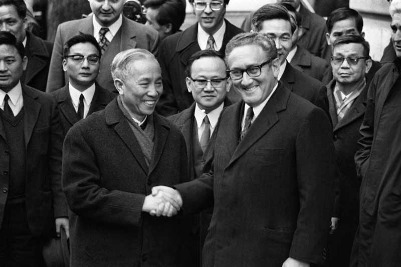 Kissinger, at right, shaking the hand of Vietnamese general and senior communist party official, Lê Đức Thọ, at peace talks in Paris, 1973. They were jointly awarded a Nobel Peace Prize. Thọ refused the award.