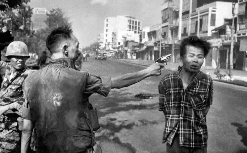 Eddie Adams (1933-2004) captured the moment police chief Brigadier General Nguyễn Ngọc Loan's bullet entered the brain of suspected Viet Cong guerilla, Nguyễn Văn Lém on 1 February 1968, during the Tet Offensive. Adams won a Pultizer Prize for one of the most iconic photos to emerge from Vietnam, or any other war. Nguyễn Văn Lém was thought to have executed seven family members, including six children, of one of Nguyễn Ngọc Loan's officers.
