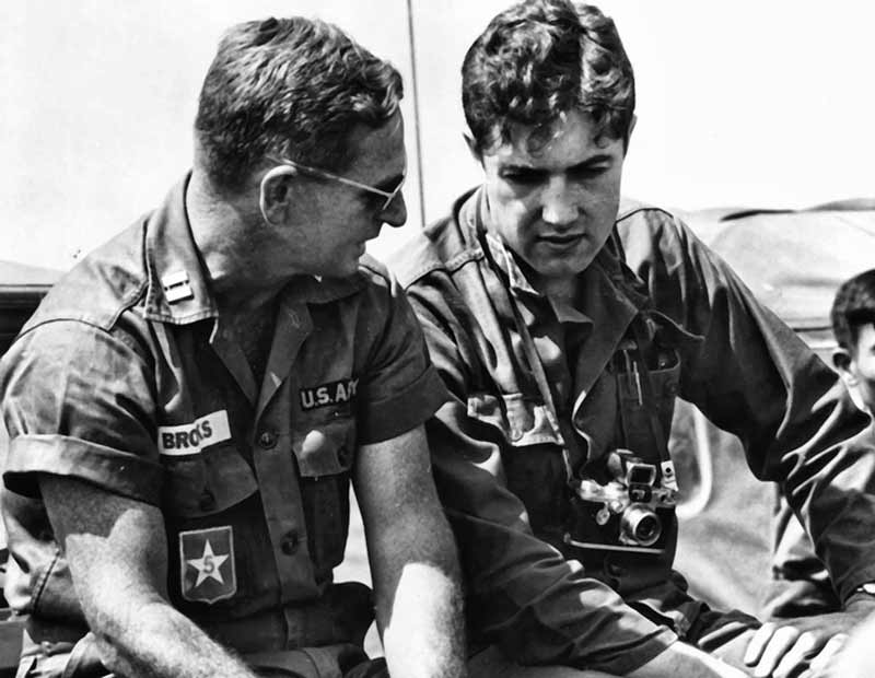 Journalist Neil Sheehan (1936-2021) on the right, seen talking to an American captain in Vietnam, mid-1960s.